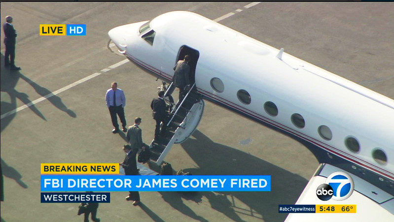 . This still frame from video provided by KABC-TV shows former FBI director James Comey, at top of stairs, and his entourage boarding a private jet at Los Angeles International Airport Tuesday, May 9, 2017. Comey was scheduled to make an early-evening speech in Los Angeles, but was fired by President Donald Trump earlier in the day. (KABC-TV via AP)