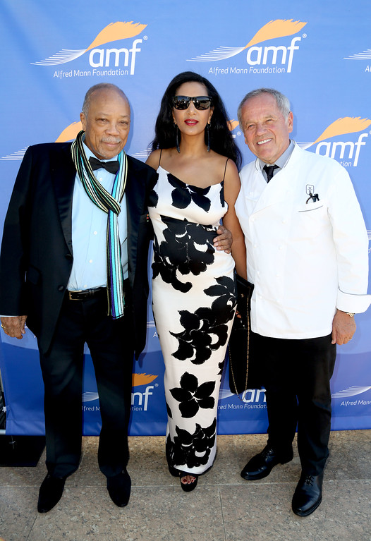 . LOS ANGELES, CA - JUNE 08:  (L-R) Quincy Jones, Gelila Assefa, and Wolfgang Puck attend Alfred Mann Foundation\'s an Evening Under The Stars with Andrea Bocelli on June 8, 2015 in Los Angeles, California.  (Photo by Rachel Murray/Getty Images for The Alfred Mann Foundation)