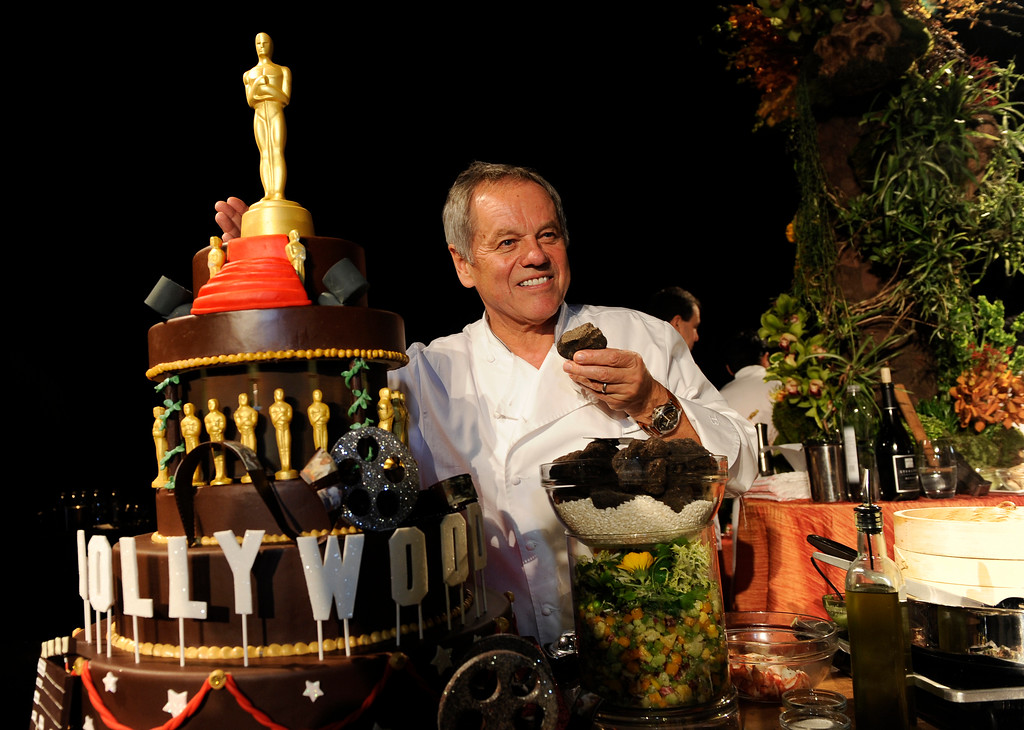 . Chef Wolfgang Puck poses with menu samples at the Governors Ball Press Preview for the 86th Oscars, on Thursday, Feb. 20, 2014, in Los Angeles. The official post-Oscar celebration will immediately follow the Oscars ceremony on Sunday, March 2 in Los Angeles. (Photo by Chris Pizzello/Invision/AP)