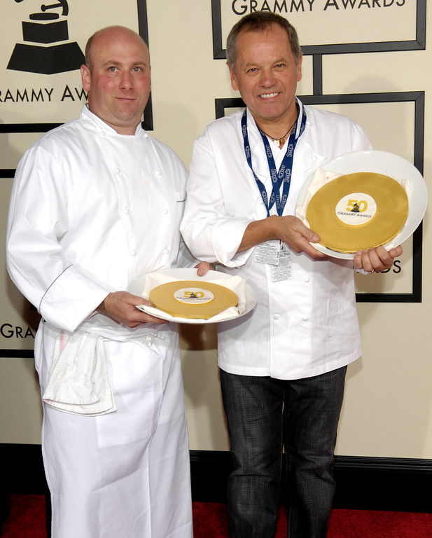 . Chef Wolfgang Puck, left, arrives at the 50th Annual Grammy Awards on Sunday, Feb. 10, 2008, in Los Angeles. (AP Photo/Chris Pizzello)