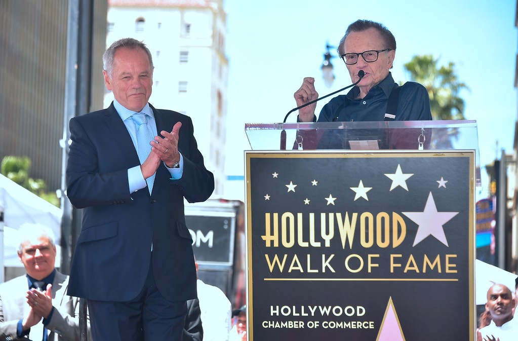 . Celebrity chef Wolfgang Puck reacts as television personality Larry King speaks at Puck\'s Walk of Fame Star ceremony in Hollywood, California on April 26, 2017 where he was the recipient of the 2,608 Star in the category of Television. (FREDERIC J. BROWN/AFP/Getty Images)