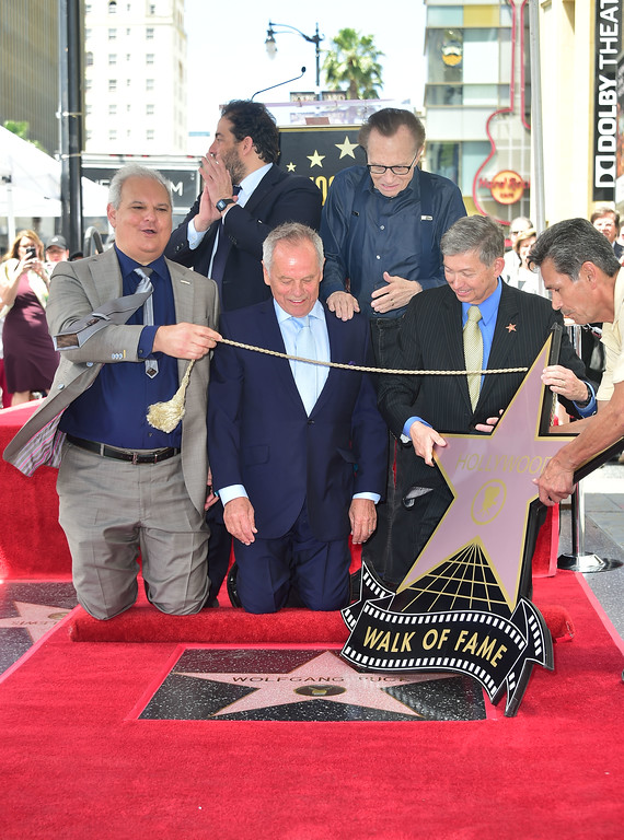 . Celebrity chef Wolfgang Puck reacts at his Walk of Fame Star ceremony in Hollywood, California on April 26, 2017 where he was the recipient of the 2,608 Star in the category of Television. (FREDERIC J. BROWN/AFP/Getty Images)