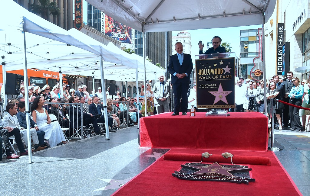 . Celebrity chef Wolfgang Puck on stage with as television personality Larry King speaking at Puck\'s Walk of Fame Star ceremony in Hollywood, California on April 26, 2017 where he was the recipient of the 2,608 Star in the category of Television. (FREDERIC J. BROWN/AFP/Getty Images)