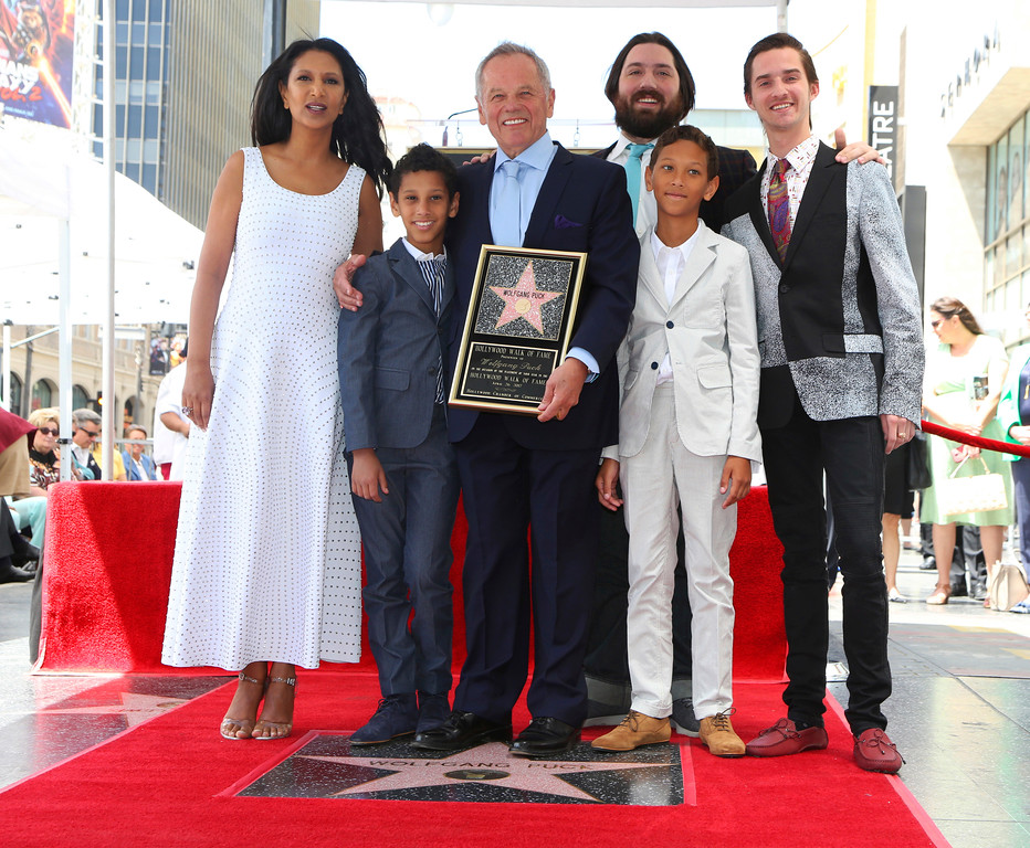 . Celebrity chef Wolfgang Puck, center, poses with his wife Gelila, from left, and sons Oliver, Cameron, Alexander and Byron at a ceremony honoring him with a star on the Hollywood Walk of Fame, Wednesday, April 26, 2017, in Los Angeles.  (AP Photo/Reed Saxon)