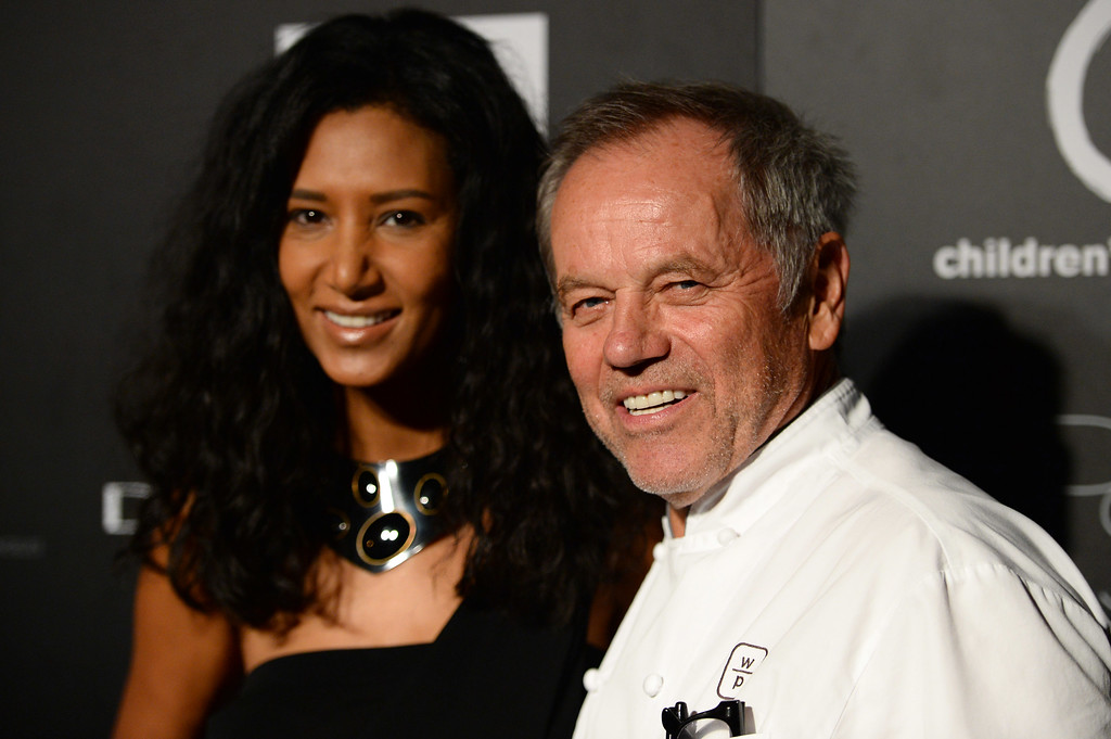 . Wolfgang Puck, right, arrives at the 5th Annual PSLA Autumn Party at 3Labs on Wednesday, Oct. 8, 2014 in Culver City, Calif. (Photo by Jordan Strauss/Invision/AP)