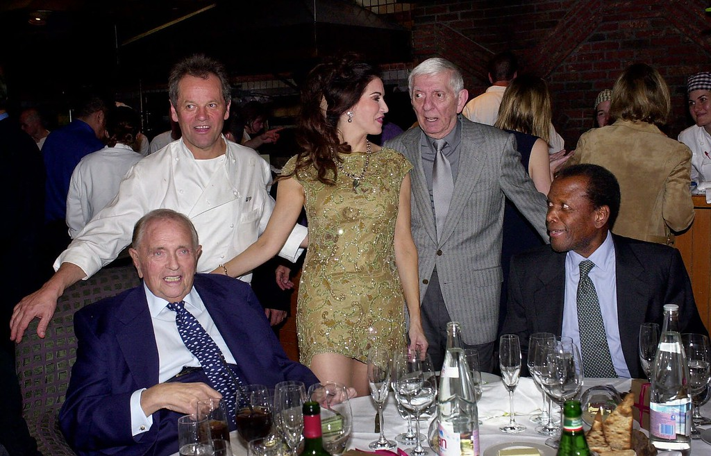 . Famous Hollywood chef  Wolfgang Puck, second left, and his wife, Barbara Lazaroff, center, join their guests financier Marvin Davis, left, actor Sidney Poitier, right, and producer Aaron Spelling at their original Spago Hollywood restaurant Wednesday, March 28, 2001, in West Hollywood, Calif.  (AP Photo/Kevork Djansezian)