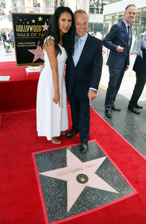 . Celebrity chef Wolfgang Puck and his wife Gelila stand on his star on the Hollywood Walk of Fame at a ceremony, Wednesday, April 26, 2017 in Los Angeles.  (AP Photo/Reed Saxon)