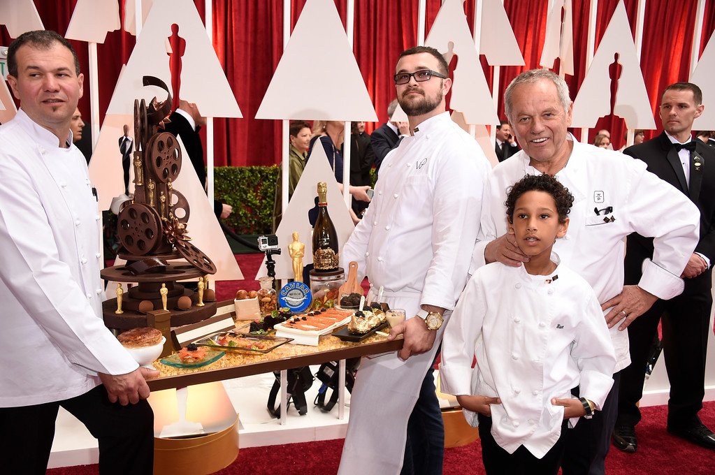 . HOLLYWOOD, CA - FEBRUARY 22:  Chef Wolfgang Puck (R) and staff attend the 87th Annual Academy Awards at Hollywood & Highland Center on February 22, 2015 in Hollywood, California.  (Photo by Frazer Harrison/Getty Images)