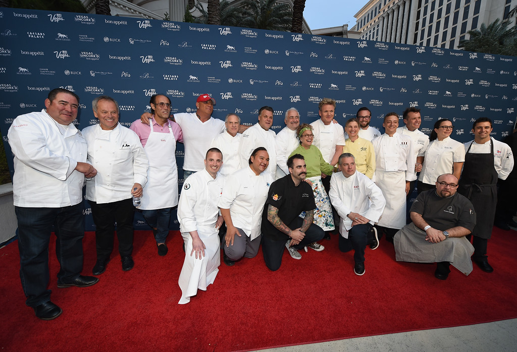 . LAS VEGAS, NV - APRIL 24:  Chefs Emeril Lagasse (L), Wolfgang Puck (2nd L), Frank Pellegrino Jr. (3rd L), Steve Martorano (4th L), Greg Sherry (5th L) Francois Payard (6th L), Guy Savoy (7th L), Susan Feniger (8th L), Gordon Ramsay (7th R), Mary Sue Milliken (6th R), Joshua Smith (5th R), Christina Wilson (2nd R) and Scott Commings (R) attend Vegas Uncork\'d by Bon Appetit\'s Grand Tasting event at Caesars Palace on April 24, 2015 in Las Vegas, Nevada.  (Photo by Ethan Miller/Getty Images for Vegas Uncork\'d by Bon Appetit)