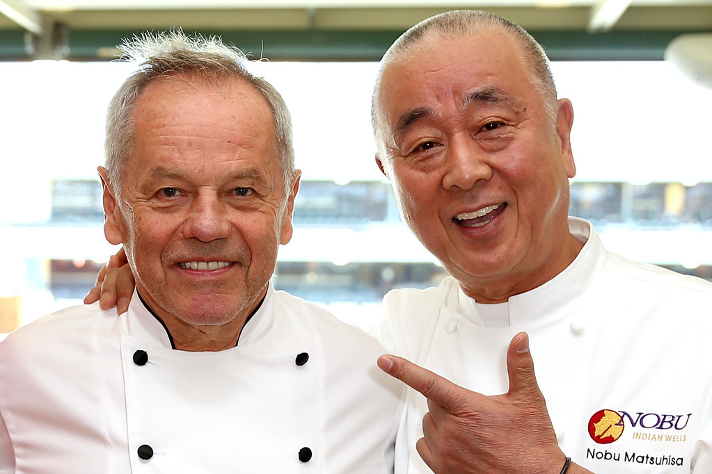 . INDIAN WELLS, CA - MARCH 07:  Celebrity chefs Wolfgang Puck and Nobu Matsuhisa pose for photograpers during the BNP Paribas Open at the Indian Wells Tennis Garden on March 7, 2017 in Indian Wells, California.  (Photo by Matthew Stockman/Getty Images)