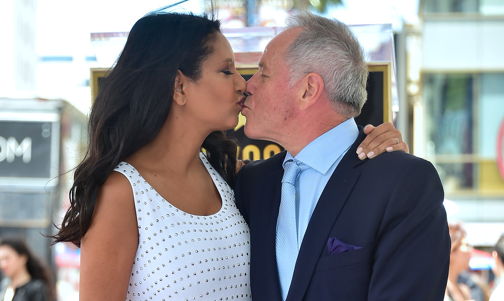 . Celebrity chef Wolfgang Puck kisses his wife Gelila on his just unveiled Star at his Walk of Fame Star ceremony in Hollywood, California on April 26, 2017 where he was the recipient of the 2,608 Star in the category of Television.  (FREDERIC J. BROWN/AFP/Getty Images)