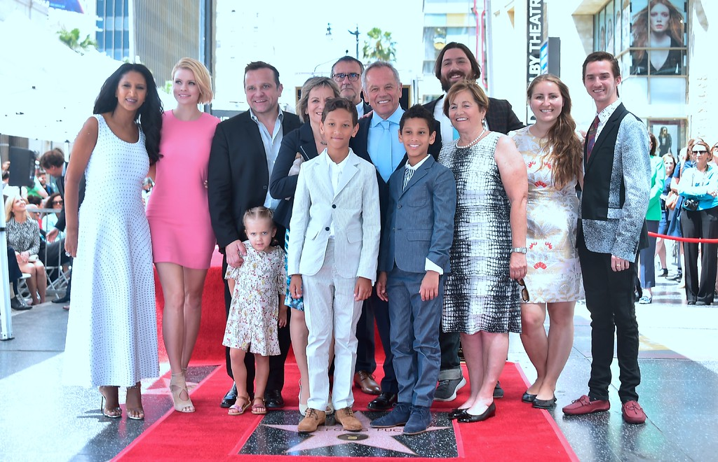 . Celebrity chef Wolfgang Puck poses with more of his family on his just unveiled Star at his Walk of Fame Star ceremony in Hollywood, California on April 26, 2017 where he was the recipient of the 2,608 Star in the category of Television. (FREDERIC J. BROWN/AFP/Getty Images)