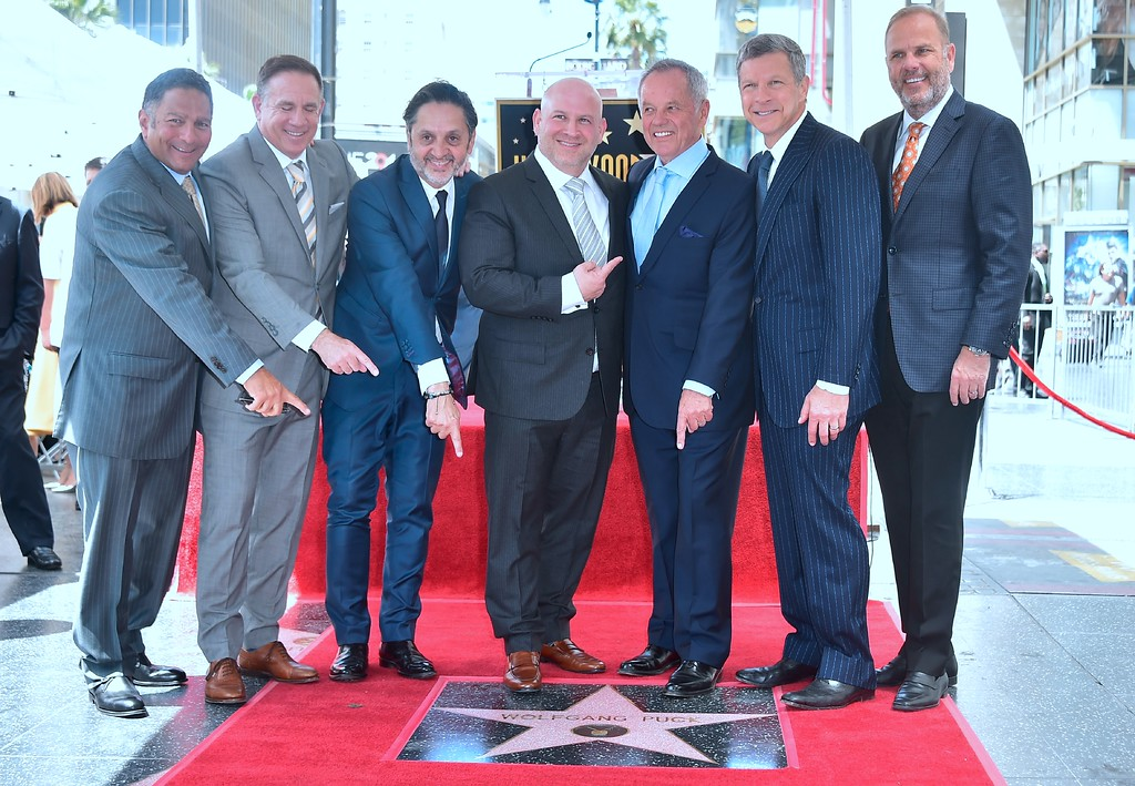. Celebrity chef Wolfgang Puck poses with his business partners on his just unveiled Star at his Walk of Fame Star ceremony in Hollywood, California on April 26, 2017 where he was the recipient of the 2,608 Star in the category of Television. (FREDERIC J. BROWN/AFP/Getty Images)