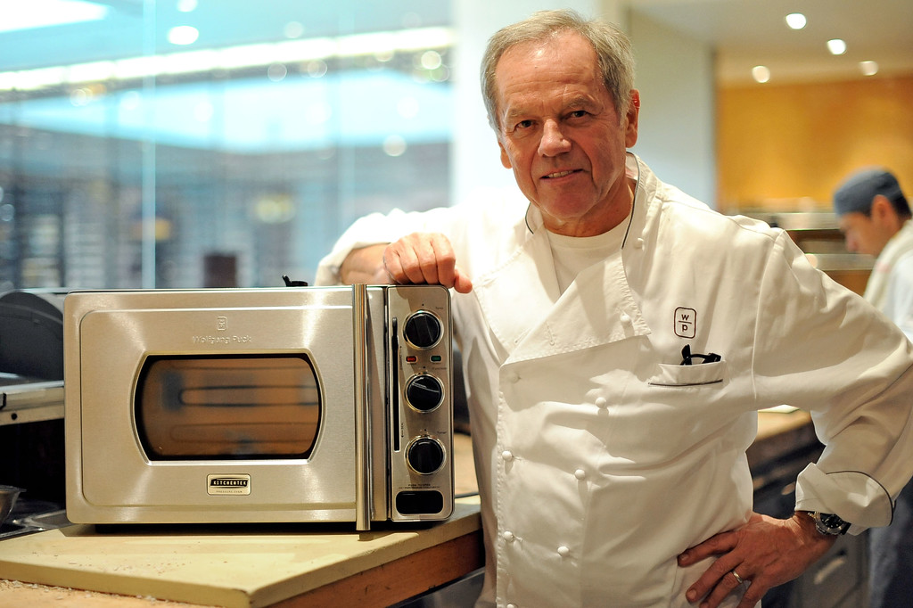 . Wolfgang Puck shows off the Wolfgang Puck Pressure Oven in Beverly Hills, CA February 6, 2014.(Andy Holzman/Los Angeles Daily News)