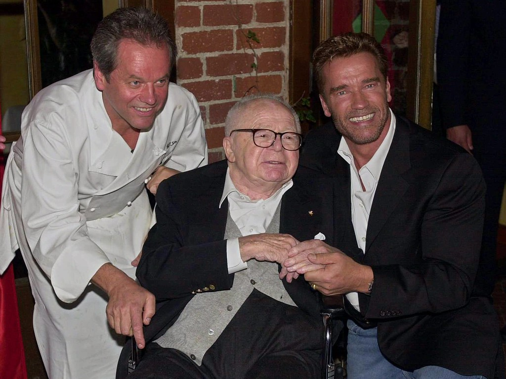. Legendary director and screenwriter Billy Wilder, center, is flanked by Arnold Schwarzenegger, right, and Wolfgang Puck prior to presenting the Billy Wilder Award in Beverly Hills, Calif., Monday Nov. 6, 2000.  (AP Photo/Michael Caulfield)