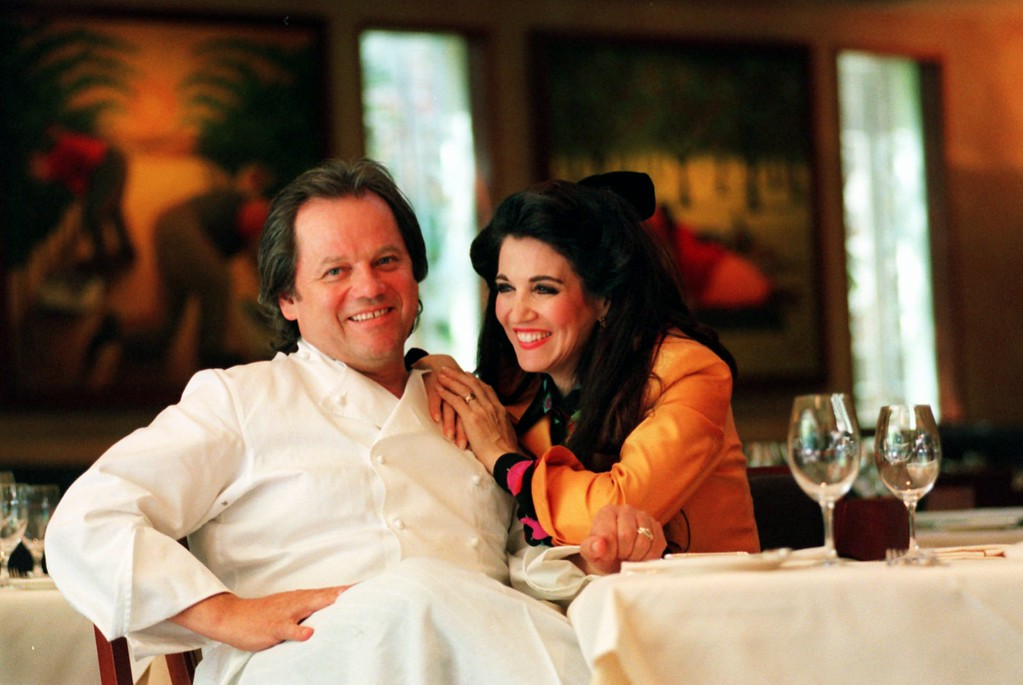 . Restaurateur Wolfgang Puck and his wife and business partner, Barbara Lazaroff, sit at a table in their Beverly Hills, Calif., restaurant Thursday, May 28, 1998. (AP Photo/Chris Pizzello)