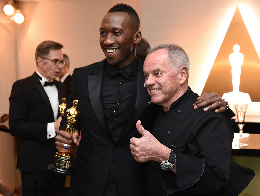 """. Mahershala Ali, left, winner of the award for best actor in a supporting role for \""""Moonlight\"""", and Wolfgang Puck at the Governors Ball after the Oscars on Sunday, Feb. 26, 2017, at the Dolby Theatre in Los Angeles. (Photo by Al Powers/Invision/AP)"""