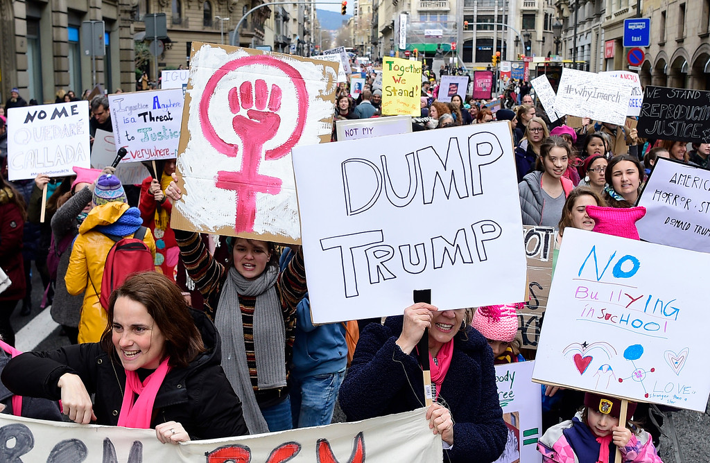 . People march holding placards in central Barcelona on January 21, 2017 in a mark of solidarity for the political rally promoting the rights and equality for women, Women\'s March on Washington, taking place today in the US capital. (LLUIS GENE/AFP/Getty Images)