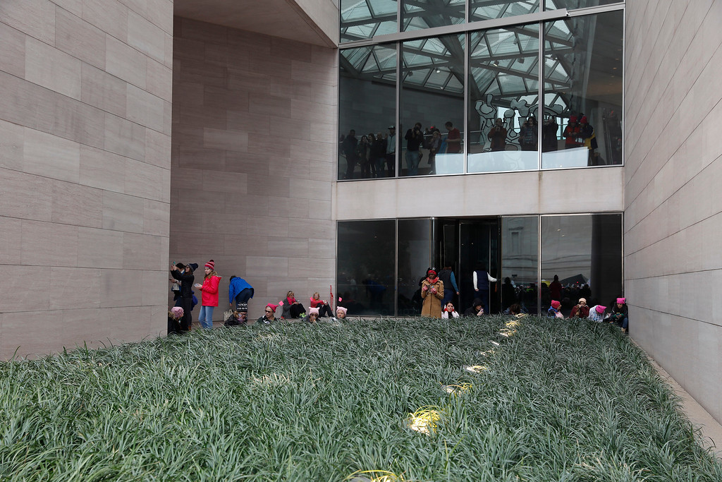 . WASHINGTON, DC - JANUARY 21:  Protesters shelter in the National Gallery of Art\'s East Building during the Women\'s March on Washington January 21, 2017 in Washington, DC. The march is expected to draw thousands from across the country to protest newly inaugurated President Donald Trump. (Photo by Aaron P. Bernstein/Getty Images)