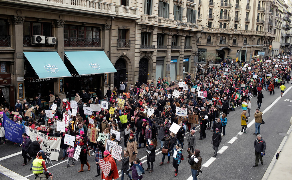. People take part during the Women\'s March rally in Barcelona, Spain, Saturday, Jan. 21, 2017. The march was held in solidarity with the Women\'s March on Washington, advocating women\'s rights and opposing Donald Trump\'s presidency. (AP Photo/Manu Fernandez)