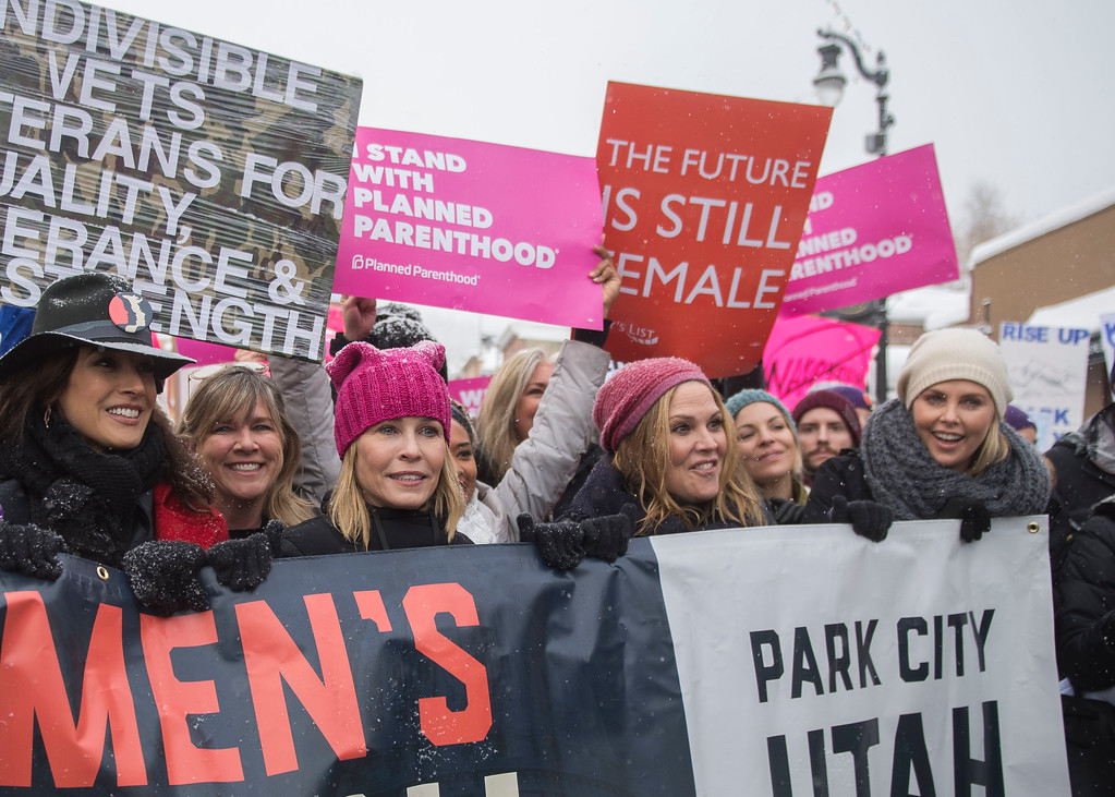 """. Actresses Chelsea Handler and Charlize Theron participate in the \""""Women\'s March On Main\"""" during the 2017 Sundance Film Festival on Saturday, Jan. 21, 2017, in Park City, Utah. (Photo by Arthur Mola/Invision/AP)"""