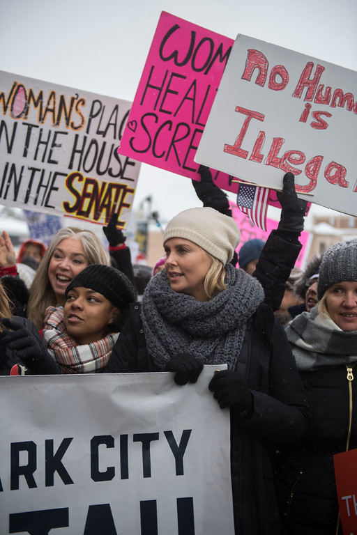""". Actress Charlize Theron participates in the \""""Women\'s March On Main\"""" during the 2017 Sundance Film Festival on Saturday, Jan. 21, 2017, in Park City, Utah. (Photo by Arthur Mola/Invision/AP)"""