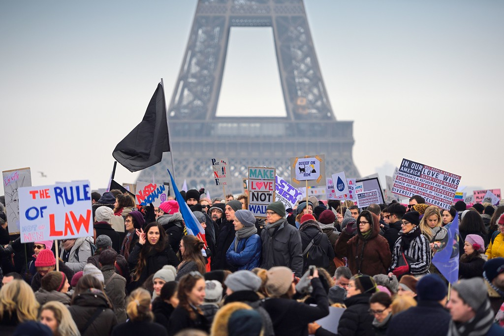 . Demonstrators carry placards during a rally in solidarity with supporters of the Women\'s March in Washington and many other cities on January 21, 2017 at the Place de Trocadero in Paris, one day after the inauguration of the US President Donald Trump. Protest rallies were held in over 30 countries around the world in solidarity with the Washington Women\'s March in defense of press freedom, women\'s and human rights following the official inauguration of Donald J Trump as the 45th President of the United States of America. (ERIC FEFERBERG/AFP/Getty Images)