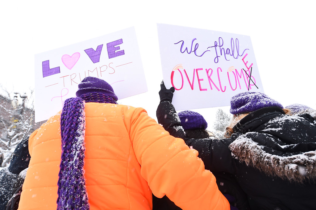 . PARK CITY, UT - JANUARY 21:  Protesters pose at the start of the Women\'s March on Main Street Park City on January 21, 2017 in Park City, Utah.  (Photo by Michael Loccisano/Getty Images)