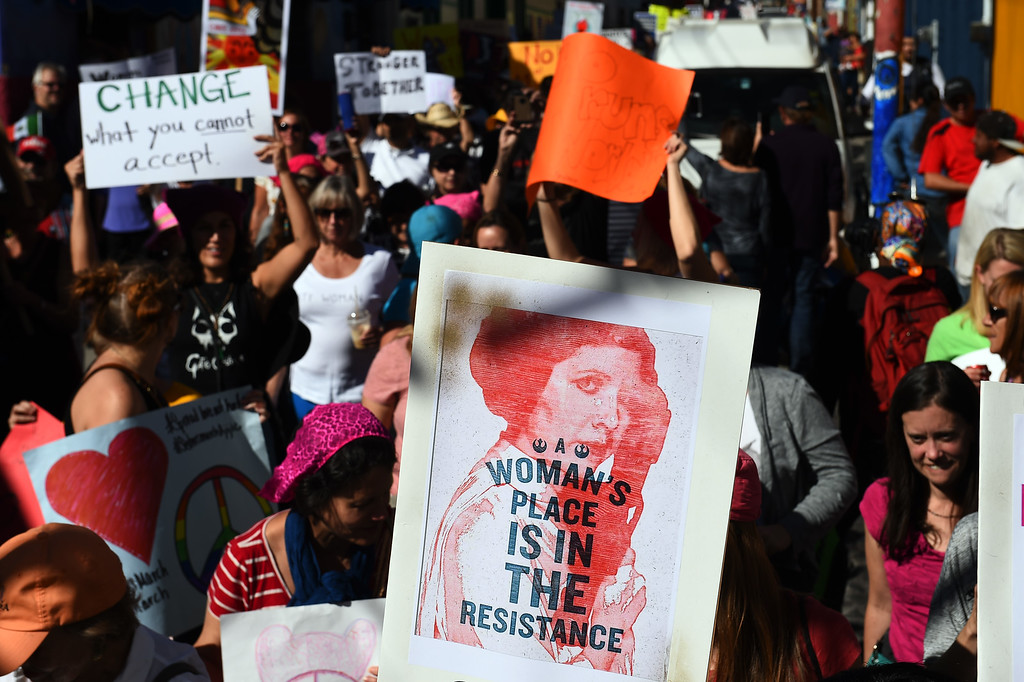""". People take part in the \""""Women\'s March\"""" in Ajijic -a city with a large community of US and Canandian nationals, mainly retired-, Jalisco state, Mexico on January 21, 2017.  The rally took place in solidarity with the Women\'s March summoned in the United States one day after the inauguration of President Donald Trump. (HECTOR GUERRERO/AFP/Getty Images)"""