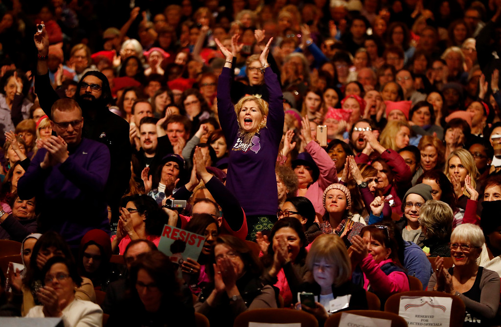 . A crowd reacts to comments by U.S. Rep. Bonnie Watson Coleman, D-NJ, during a rally in support of the national Women\'s March on Washington during a gathering at Patriots Theater at the War Memorial, Saturday, Jan. 21, 2017, in Trenton, N.J. The march was held in in conjunction with with similar events taking place around the nation following the inauguration of President Donald Trump. (AP Photo/Julio Cortez)
