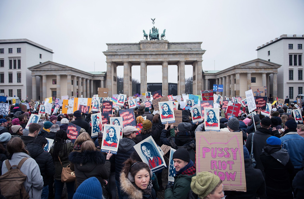 . BERLIN, GERMANY - JANUARY 21: Women attend a protest for women\'s rights and freedom in solidarity with the Women\'s March on Washington in front of Brandenburger Tor on January 21, 2017 in Berlin, Germany. The Women\'s  March originated in Washington DC but soon spread to be a global march calling on all concerned citizens to stand up for equality, diversity and inclusion and for Women\'s  rights to be recognised around the world as human rights. Global marches are now being held, on the same day, across seven continents. (Photo by Steffi Loos/Getty Images)