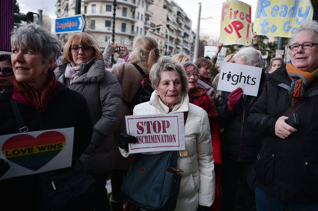 . Demonstrators hold placards and chant slogans during an demonstration in front of the US embassy in Athens on January 21, 2017, in solidarity with the Women\'s March on Washington, one day after the inauguration of Donald Trump as US President.  Protest rallies were held in over 30 countries around the world in solidarity with the Washington Women\'s March in defense of press freedom, women\'s and human rights following the official inauguration of Donald J Trump as the 45th President of the United States of America. (LOUISA GOULIAMAKI/AFP/Getty Images)