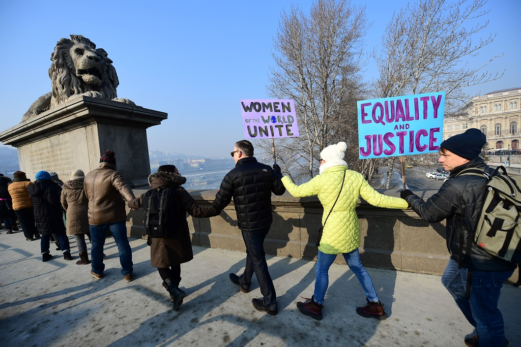 . Participants create a human-chain and walk on Lanchid (Chain Bridge) in Budapest downtown on January 21, 2017 during a women protesters march in a rally against US President Donald Trump following his inauguration. A Women\'s March kicked off, the first of a series of global protests in defence of women\'s rights, as demonstrators rally against Donald Trump, who was sworn in as the 45th president of United States on Januray 20. (ATTILA KISBENEDEK/AFP/Getty Images)