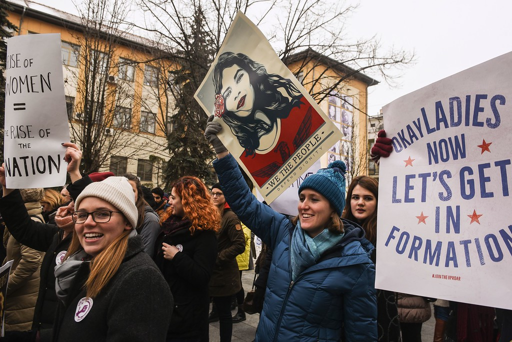 """. Women hold posters as they take part in a march  for women\'s rights and freedom in solidarity with the march organised in Washington, on January 21, 2017 in Pristina.  Hundreds of thousands of protesters spearheaded by women\'s rights groups are set to converge on Washington  to send a defiant message to America\'s new president, Donald Trump. Powered by social media, the \""""Women\'s March on Washington\"""" aims to draw 200,000 people, illustrating the divisions of a country whose incoming leader faces levels of public mistrust unseen in recent decades. (ARMEND NIMANI/AFP/Getty Images)"""