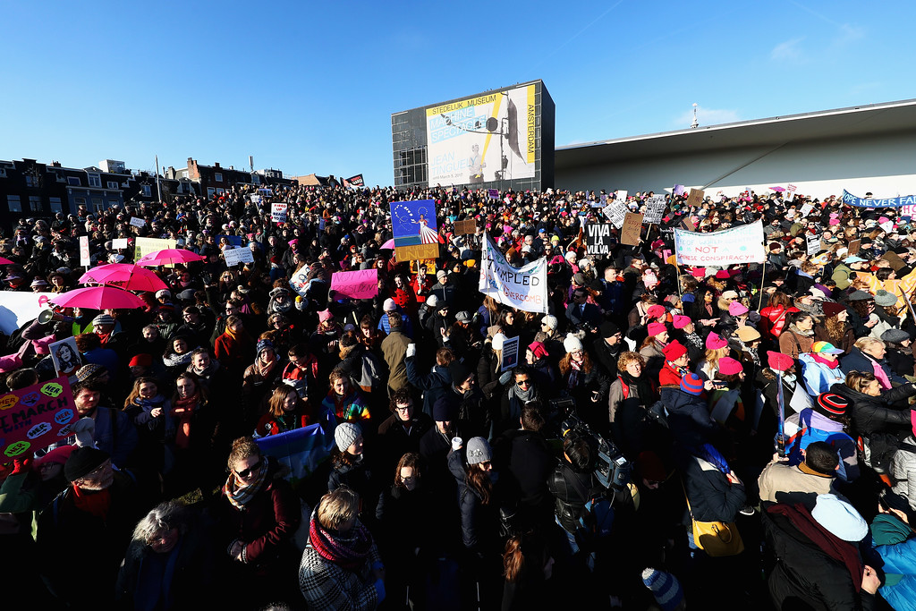 . AMSTERDAM, NETHERLANDS - JANUARY 21:  Demonstrators make their way from the iamsterdam statue in front of the Rijksmuseum towards US Consulate during the Women\'s March held at Museumplein on January 21, 2017 in Amsterdam, Netherlands.  The Women\'s March originated in Washington DC but soon spread to be a global march calling on all concerned citizens to stand up for equality, diversity and inclusion and for women\'s rights to be recognised around the world as human rights. Global marches are now being held, on the same day, across seven continents.  (Photo by Dean Mouhtaropoulos/Getty Images)