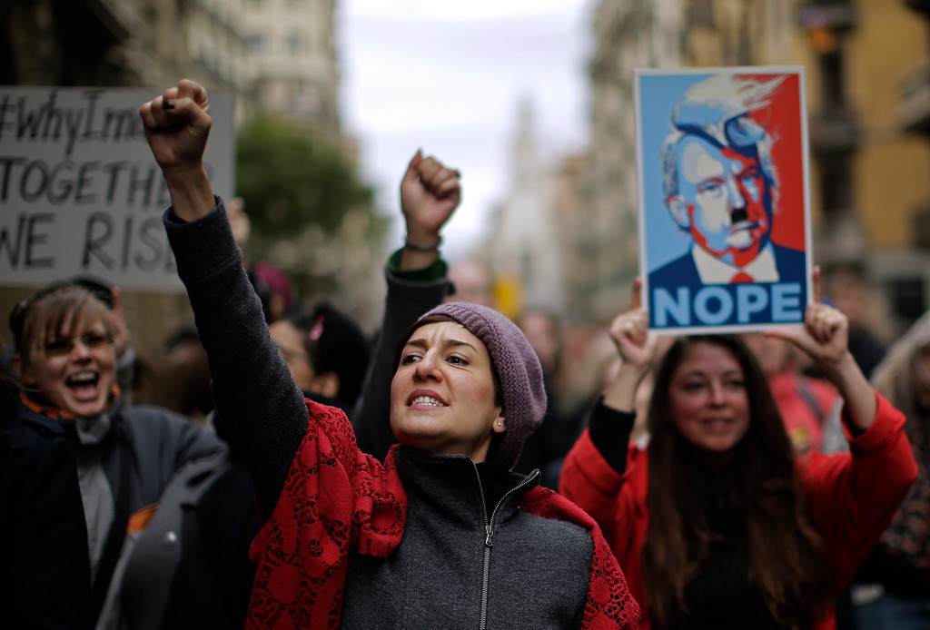 . People shouts slogans during the Women\'s March rally in Barcelona, Spain, Saturday, Jan. 21, 2017. The march was held in solidarity with the Women\'s March on Washington, advocating women\'s rights and opposing Donald Trump\'s presidency. (AP Photo/Manu Fernandez)