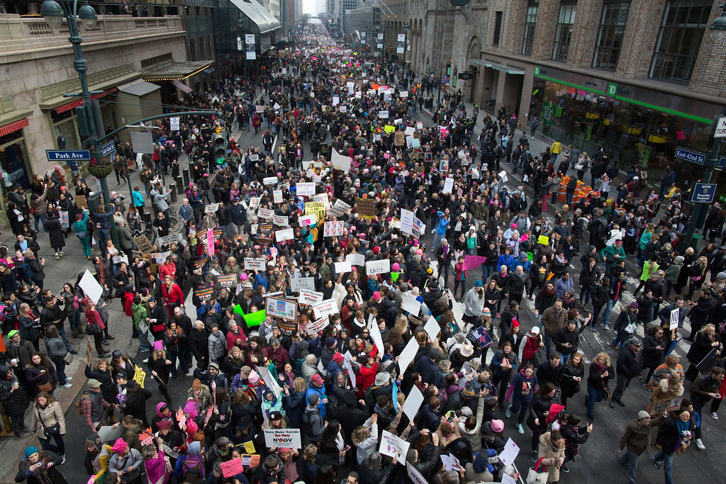 . Demonstrators march across 42nd Street during a women\'s march, Saturday, Jan. 21, 2017, in New York.  The march is being held in solidarity with similar events taking place in Washington and around the nation.(AP Photo/Mary Altaffer)