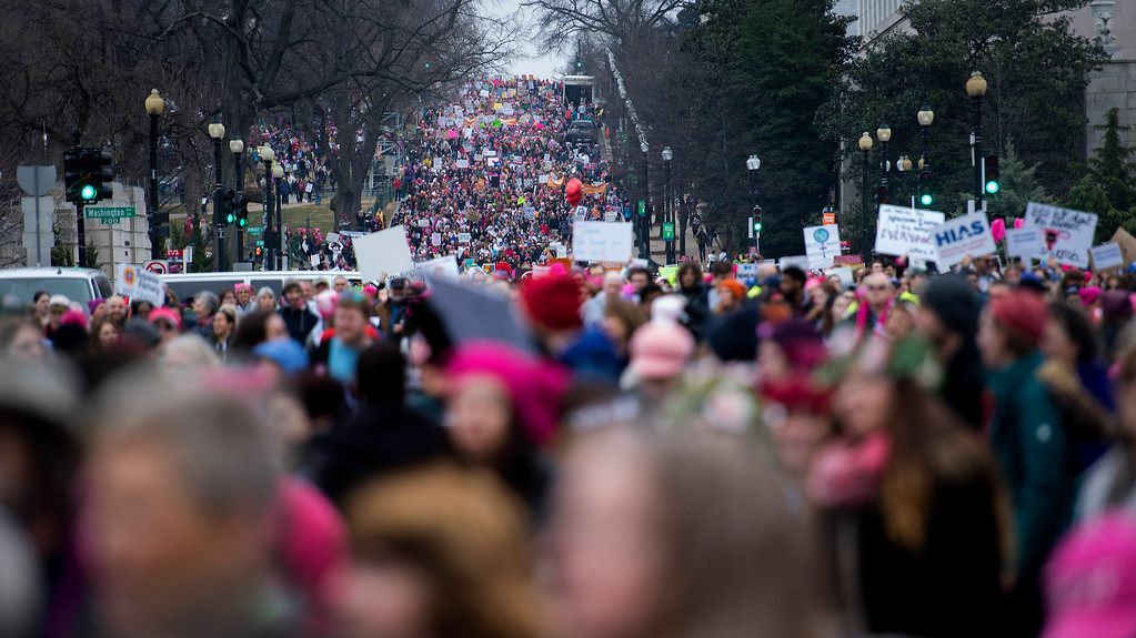 . Demonstrators march on the National Mall in Washington, DC, for the Women\'s march on January 21, 2017. Hundreds of thousands of protesters spearheaded by women\'s rights groups demonstrated across the US to send a defiant message to US President Donald Trump. (JIM WATSON/AFP/Getty Images)