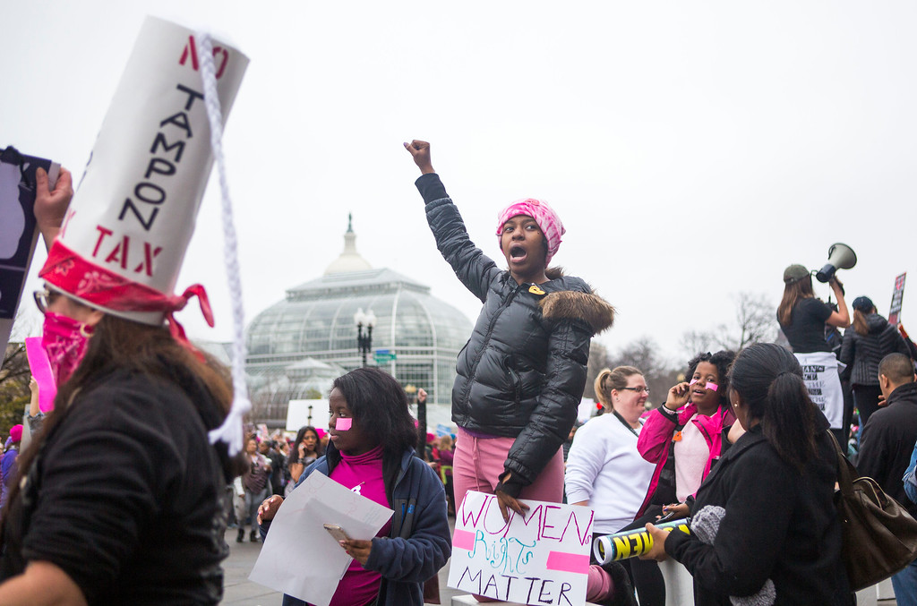 . WASHINGTON, DC - JANUARY 21: Protesters attend the Women\'s March on Washington on January 21, 2017 in Washington, DC. Following the inauguration of Donald Trump as the 45th president of the United States, the Womens March has spread to be a global march calling on all concerned citizens to stand up for equality, diversity and inclusion and for womens rights to be recognised around the world as human rights.  (Photo by Jessica Kourkounis/Getty Images)