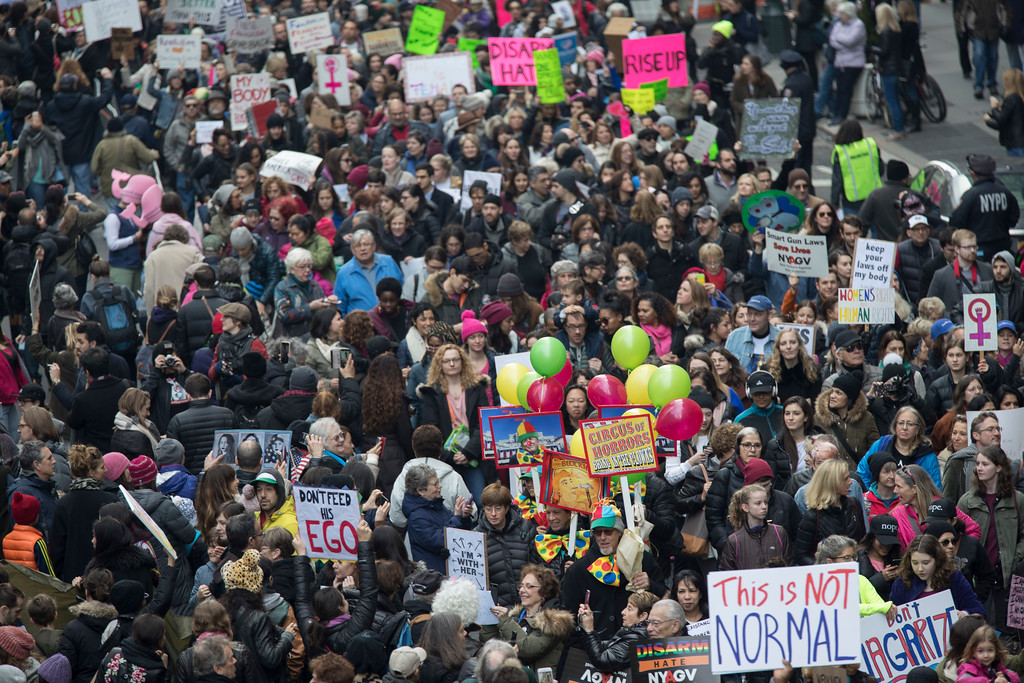 . Demonstrators march across 42nd Street during a women\'s march, Saturday, Jan. 21, 2017, in New York. The march is being held in solidarity with similar events taking place in Washington and around the nation. (AP Photo/Mary Altaffer)