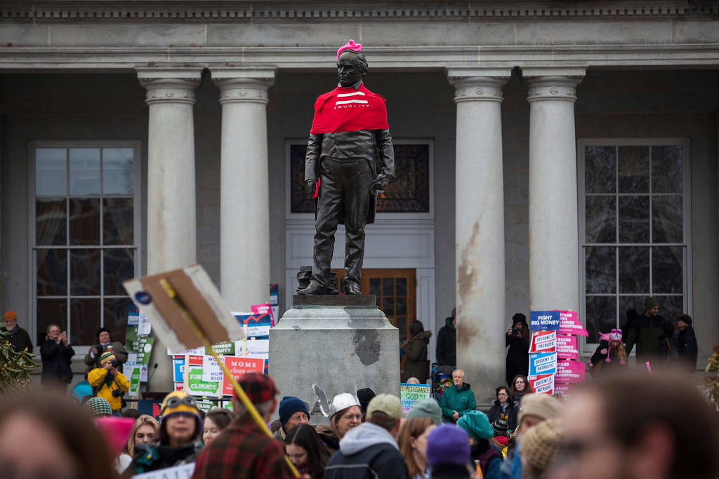 . A statue of Daniel Webster is seen wearing a pink pussy hat and red equality shirt during the New Hampshire Women\'s Day of Action and Unity rally in front of the State House in Concord, N.H., on Saturday, Jan. 21, 2017. (Elizabeth Frantz/Concord Monitor via AP)