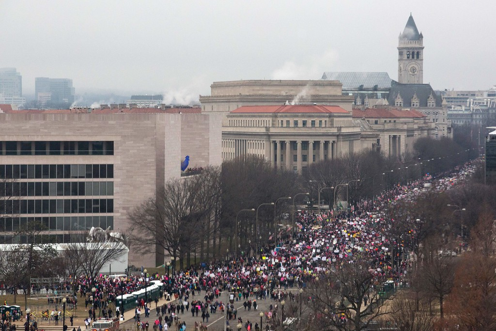 . Protesters walk up Pennsylvania Avenue in Washington, DC, during the Womens March on January 21, 2017.  Hundreds of thousands of people flooded US cities Saturday in a day of women\'s rights protests to mark President Donald Trump\'s first full day in office. (ZACH GIBSON/AFP/Getty Images)