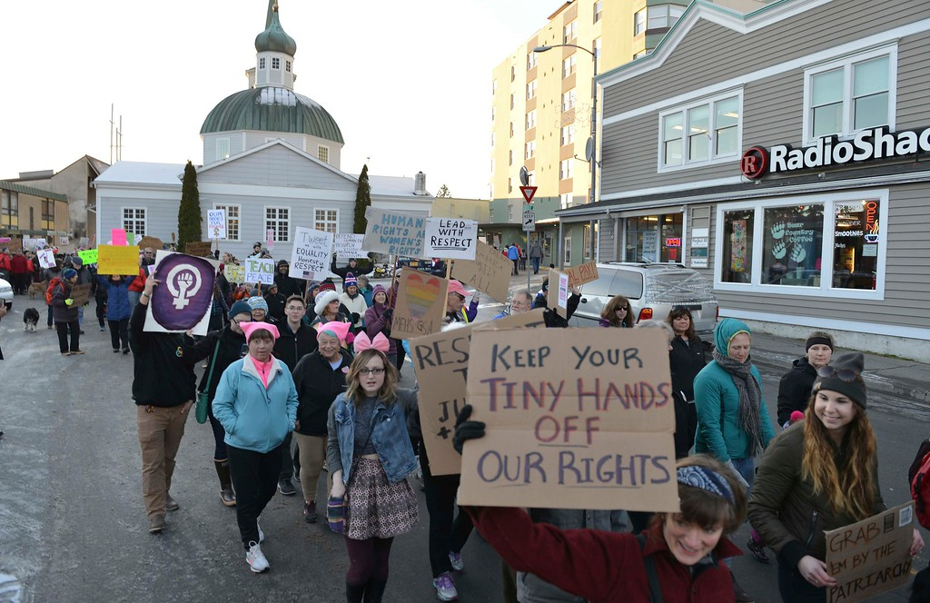 . Hundreds of people march in downtown Sitka, Alaska, during the women\'s march, held in solidarity with the Women\'s March on Washington, Saturday, Jan. 21, 2017. (James Poulson/The Daily Sitka Sentinel via AP)