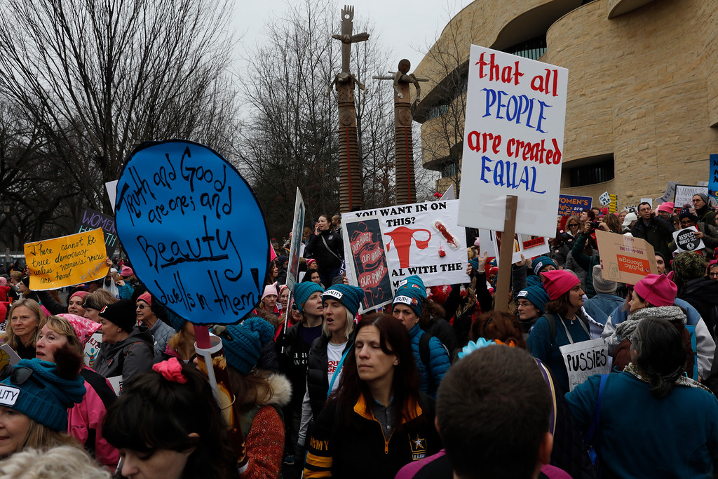. WASHINGTON, DC - JANUARY 21: Protesters gather during the Women\'s March on Washington January 21, 2017 in Washington, DC. The march is expected to draw thousands from across the country to protest newly inaugurated President Donald Trump. (Photo by Aaron P. Bernstein/Getty Images)