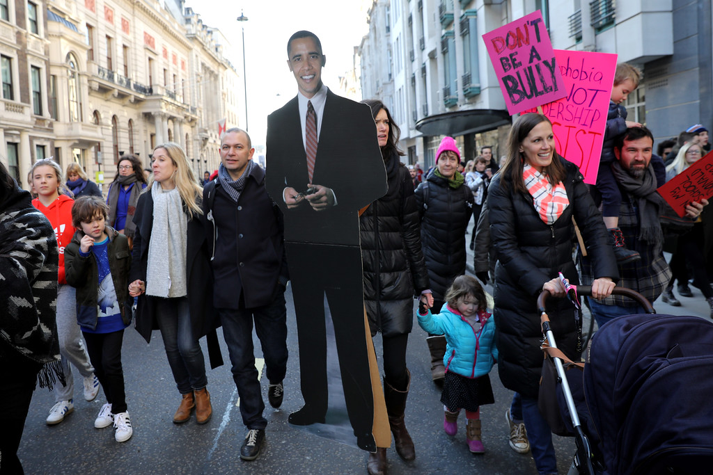 . LONDON, ENGLAND - JANUARY 21:  Protesters make their way through the streets of London with a life size cut out of former President Barack Obama during the Women\'s March on January 21, 2017 in London, England. The Women\'s March originated in Washington DC but soon spread to be a global march calling on all concerned citizens to stand up for equality, diversity and inclusion and for Women\'s rights to be recognised around the world as human rights. Global marches are now being held, on the same day, across seven continents  (Photo by Dan Kitwood/Getty Images)