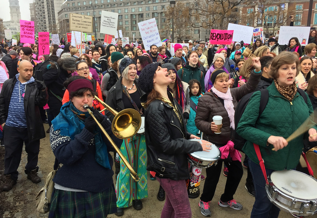 . Protesters gather for the Women\'s March on Philadelphia a day after Republican Donald Trump\'s inauguration as president, Saturday, Jan. 21, 2017 in Philadelphia.  The march is being held in solidarity with similar events taking place in Washington and around the nation.  (AP Photo/Jacqueline Larma)