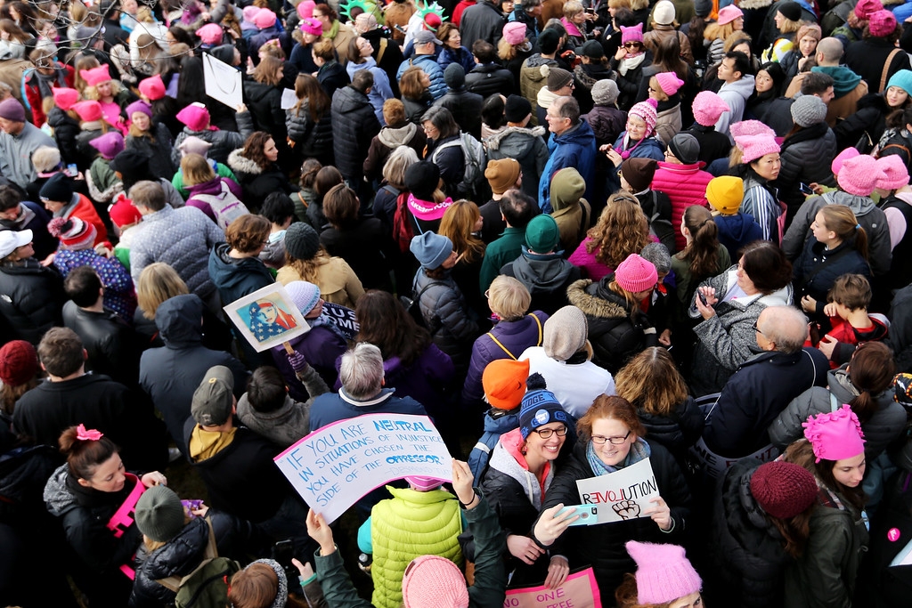 . BOSTON, MA - JANUARY 21: Demonstrators gather on Boston Common during the Boston Women\'s March for America on January 21, 2017 in Boston, Massachusetts.Thousands of demonstrators took to the streets in protest after the inauguration of President Donald Trump.(Photo by Maddie Meyer/Getty Images)