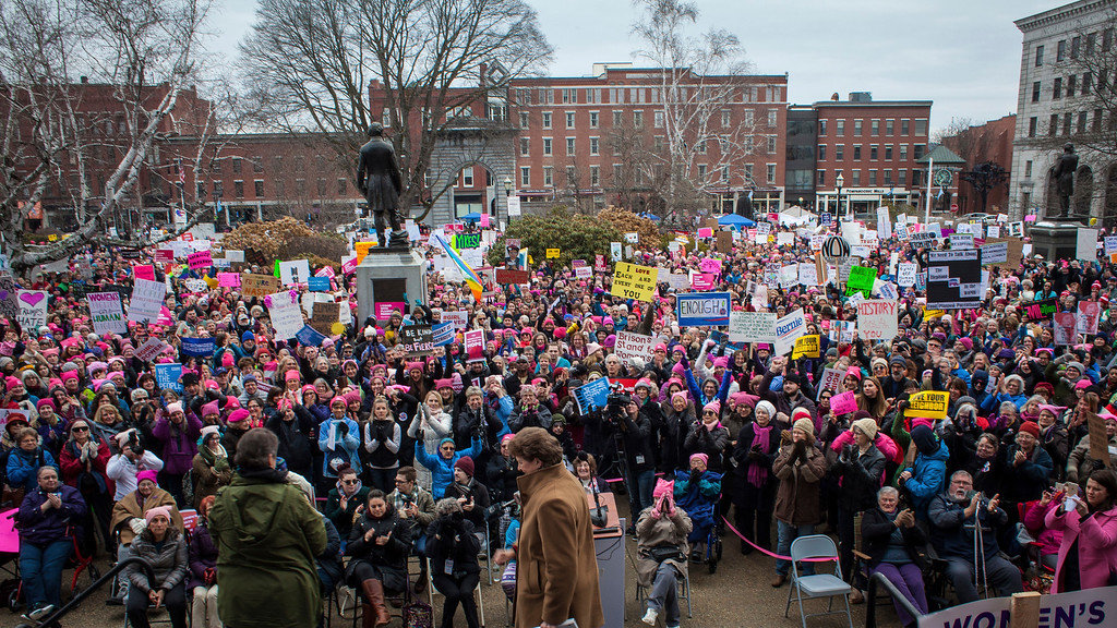 . The crowd cheers as U.S. Sen. Jeanne Shaheen, the first woman in the United States to be elected governor and U.S. Senator, leaves the stage after speaking during the New Hampshire Women\'s Day of Action and Unity rally in front of the State House in Concord, N.H., on Saturday, Jan. 21, 2017. (Elizabeth Frantz/Concord Monitor via AP)