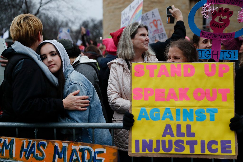 . Protestors wait for speakers to begin their speeches in the cold along the barricades at the Women\'s March on Washington during the first full day of Donald Trump\'s presidency, Saturday, Jan. 21, 2017 in Washington. Organizers of the Women\'s March on Washington expect more than 200,000 people to attend the gathering. Other protests are expected in other U.S. cities. (AP Photo/John Minchillo)