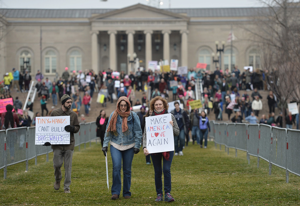 . Demonstrators protest on the National Mall in Washington, DC, for the Women\'s March on January 21, 2017. Hundreds of thousands of protesters spearheaded by women\'s rights groups demonstrated across the US to send a defiant message to US President Donald Trump. (ANDREW CABALLERO-REYNOLDS/AFP/Getty Images)
